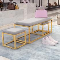 Nordic minimalist iron light luxury change shoe stools on the doorstep of the cloakroom clothing shop shoe shop rest benches.