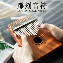 Taiwans 17-tone thumb piano carved speaker caramba finger piano peach core wood beginner refers to the Western musical instrument