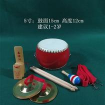 Hand-knocking drummer stomps boys and girls double-sided drums Kids children small children play with toy drums