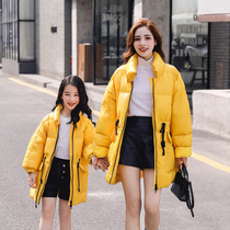 Parent-child winter clothing 2019 New Girl winter down jacket Korean version of the net red warm down female wear pure color tide